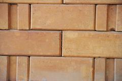 The brick background is perfect for a calm atmosphere. Stock Photos
