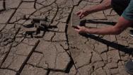 Stock Video Footage of 4K Geologist Studies Cracked Earth Or Mudcracks