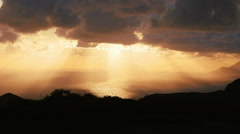 Sunlight throw the clouds in warm sunset on the sea: Sicily, Italy, summer Stock Footage