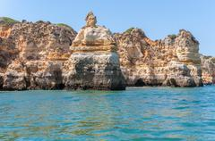 Rock formations near lagos seen from the water Stock Photos