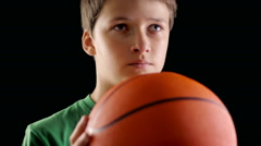 Child throwing a basketball in studio, future Stock Footage