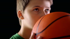 Boy throwing a basketball - stock footage