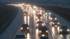 TRAFFIC WET SLOW DRIVE Stock Footage
