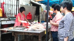 Chicken stalls at the farmer's market, in China Stock Footage