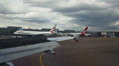 0497 British Airways aircrafts reaching terminal - stock footage