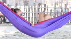 Lady on holidays napping on hammock - stock footage