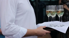 Waiter offer a glass of champagne Stock Footage