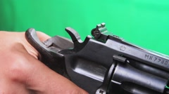 Man Hand Reloads a Revolver IV Stock Footage