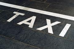 Stock Photo of taxi stand sign on the road