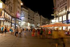 Tourists walk at night in center of vienna Stock Photos