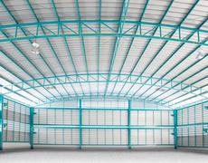 Inside of structure empty warehouse use for industry background and multipurp Stock Photos