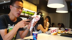 Enjoy Food at KFC restaurant Stock Footage