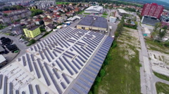 Industrial complex with solar panels on roof aerial footage Stock Footage