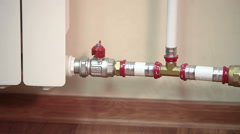 Turning on red valve of central heating for hot water supplying Stock Footage