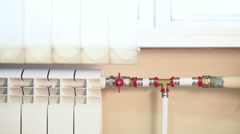 Central heating with shut off valves on pipes, nobody Stock Footage