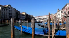 Gongolas on the waves on Rialto Bridge background, Venice Stock Footage