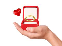 Stock Illustration of hand hold a gift box with wedding ring