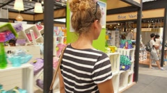 Young Curly Woman Shopping in Mall Stock Footage