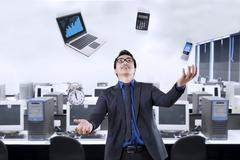 Businessperson juggling with business items Stock Illustration