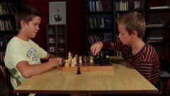 Kids playing chess in the game room. Boys holding hands black and white figures. Stock Footage