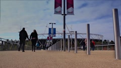 Tourists and locals walk in front of the unfinished Olympic stadium. Stock Footage