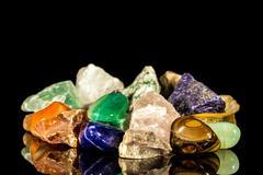 Various gemstones, uncut and tumble finishing Stock Photos