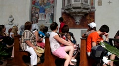 Tourists in La Collegiata cathedral, San Gimignano, Tuscany Stock Footage