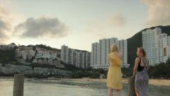 Hong Kong Beach Women enjoying sunset at Repulse Bay Stock Footage