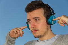 Young man with headphones music Stock Photos