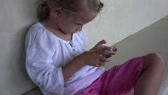 Little Girl Playing on Smartphone while Traveling, Child, Kid on Phone 4K Stock Footage