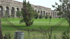 Golf Course beside imposing Aqueduct in Rome, 4k Stock Footage