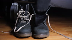 Woman Putting On A Boot And Starts Tying Shoelaces, Front Shot Stock Footage