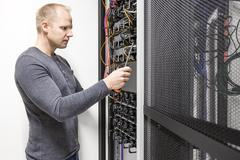 Installs communication rack in datacenter Stock Photos