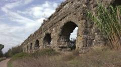 Jet overhead, bicycle on path, Aqua Claudia Aqueduct, Rome 4k Stock Footage