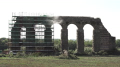 Repairing Aqueduct, train passes below 4k Stock Footage