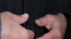 Woman Hands Unbuttoning a Coat, Hand, Button, Detail, Side Shot Stock Footage