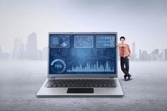 Male manager leans on laptop Stock Illustration