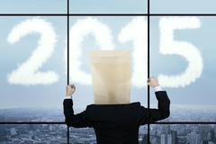 Optimist businessperson looking at number 2015 Stock Illustration
