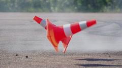Car hits cones Stock Footage