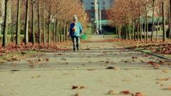 Road autumn trees leaves people Stock Footage