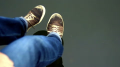 Man moving his feet in water.Fokus on water Stock Footage