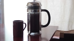Pouring a hot cup of coffee from french press Stock Footage