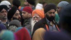 Sikh men singing traditional music during Nagar Kirtan Stock Footage