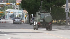 Canadian army truck driving in blacked out city core with no power Stock Footage