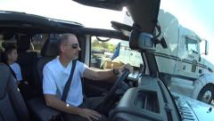 18 Wheeler passes father and son driving a Jeep - stock footage