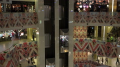 the movement of people in a large multi-level shopping and entertainment complex - stock footage