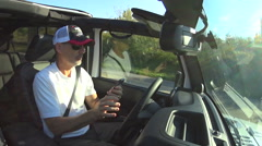 Texting while driving Jeep, grab steering wheel to avoid accident - stock footage