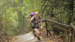 Mount Kinabalu Trek Woman hiking slow motion - stock footage