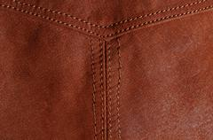 Seam in brown leather jacket Stock Photos