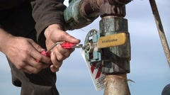 Oil Worker Installs Lock Out Tag Stock Footage